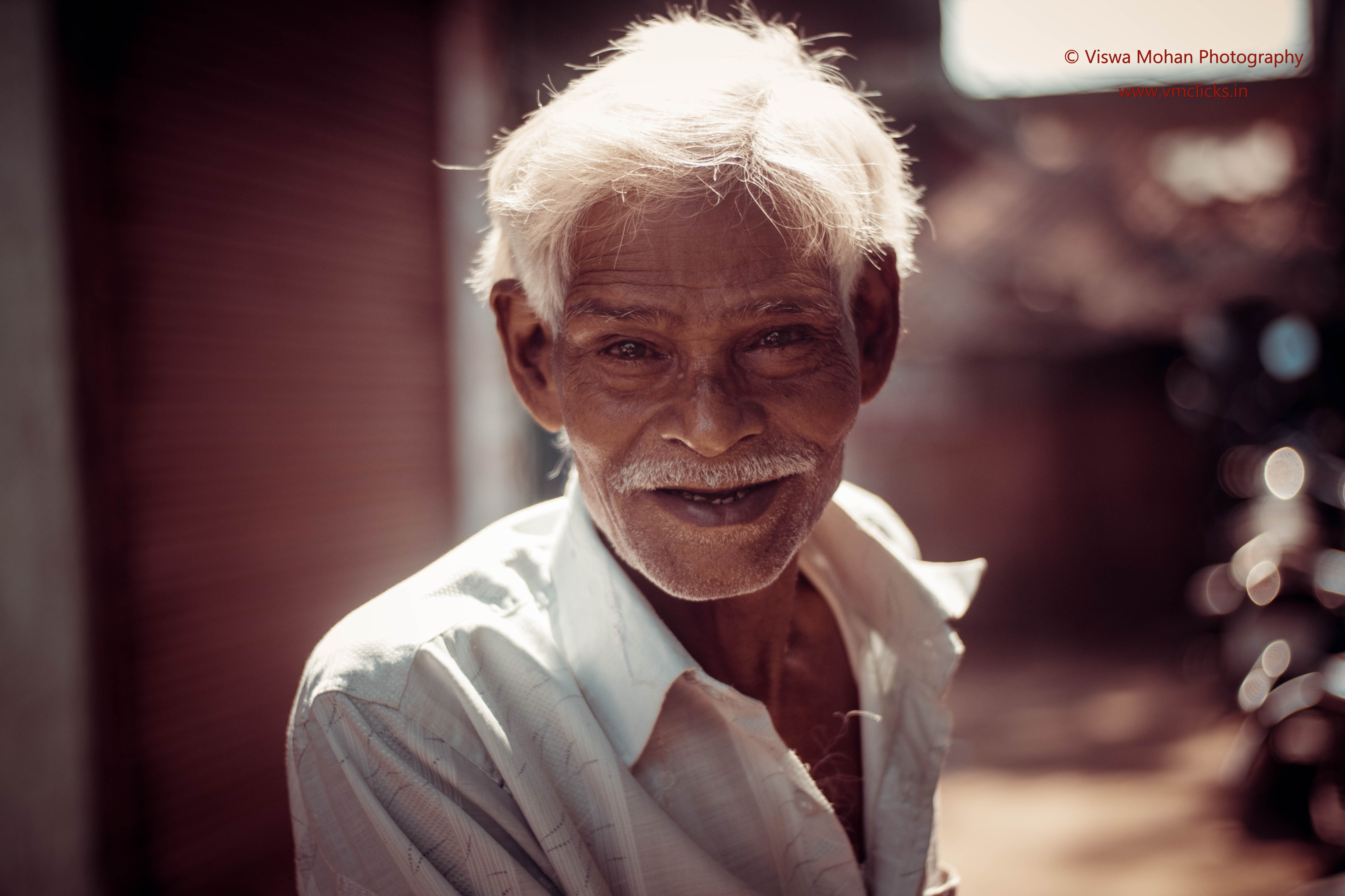 "Old Man with smile on his face : ""Happiness is enjoying every moment of Life"""