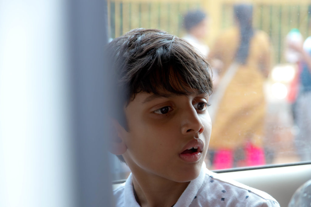 Kid looking at his friends inside cab