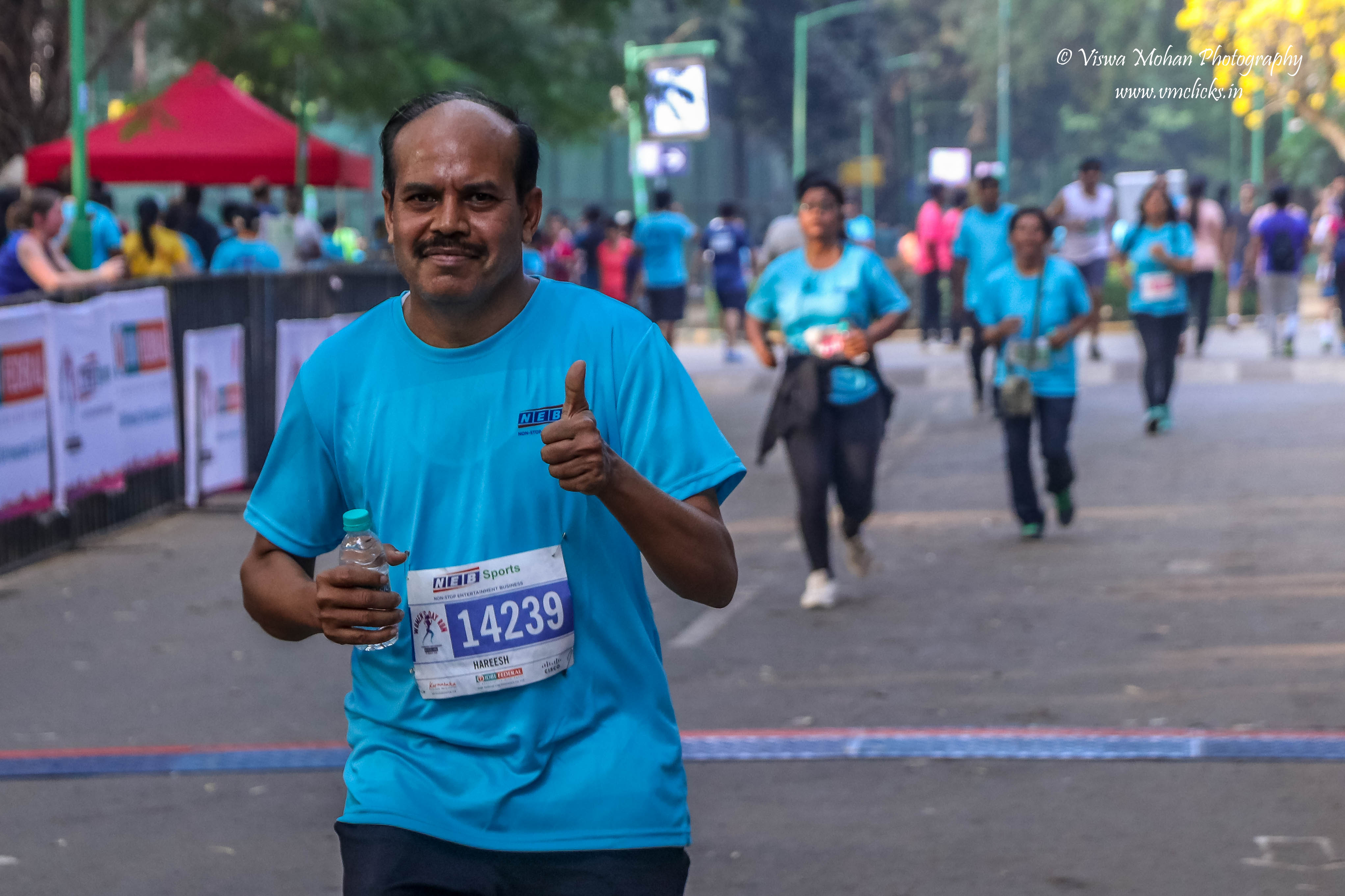 Gentleman Giving Thumsup after successful Marathon